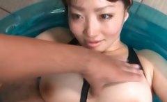 Asian sex doll gets teased thru her torn swim suit